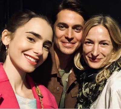 Lucas Bravo with Lily Collins and Zoe Cassavetes